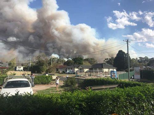 The bushfire came within metres of homes in Menai. (Luke Cooper)