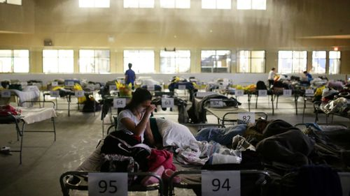 Thousands of people are being forced to shelter in evacuation centres. (AFP)