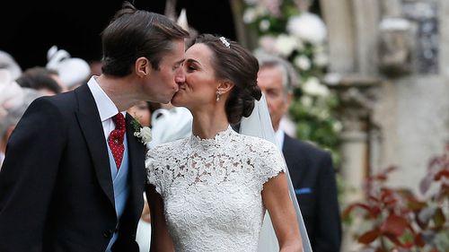 Pippa Middleton kisses her husband James Matthews. (AAP)
