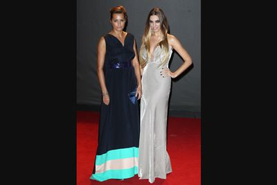 Wearing floor-length royal blue and white velvet dresses