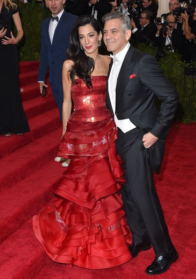 George, in Armani, and Amal Cooney wearing John Galliano, at the 2015 Met Gala Ball