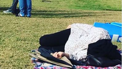 If you need me I'll be over here. Mum catches some shut eye at soccer. Image: Facebook/Glennon Doyle.