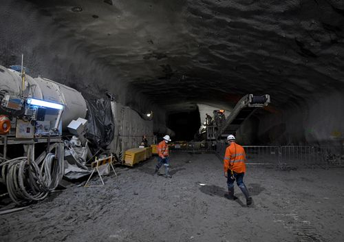 A roadheader and construction worker work on the eastbound WestConnex M4 tunnel at Concord in Sydney, June, 2017. (AAP)