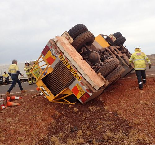 The driver was trapped for almost an hour.