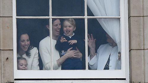 Prince George watched the beginning of the parade from a window with his nanny. (AAP)