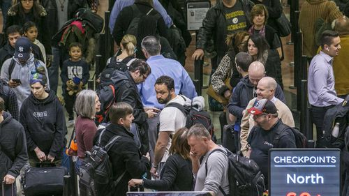 Air travellers endured waits of more than an hour to get through domestic checkpoints at Hartsfield-Jackson International Airport in Atlanta