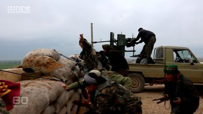 YPJ fighters fire on Islamic State positions.