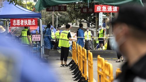 A Shanghai neighborhood under lockdown, after a resident tested positive for COVID-19.
