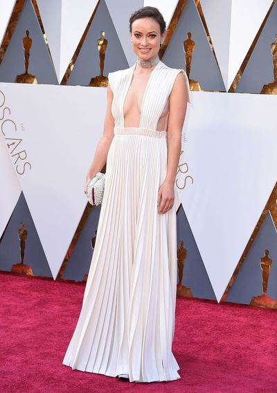 "<p>Olivia Wilde in Valentino haute couture.&nbsp;</p> <p>Note the sheer panel subtly keeping everything in place. ""You gotta do that!"" the actress told ET. ""Come on. No risks tonight!""</p>"