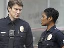 Nathan Fillion and Afton Williamson in The Rookie