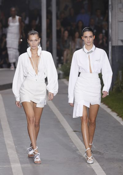 Bella Hadid and Kendall Jenner walk the runway during the Off-White show as part of the Paris Fashion Week Womenswear Spring/Summer 2019
