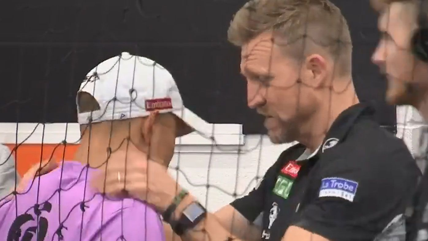 Nathan Buckley consoles heartbroken Magpies runner after grand final loss