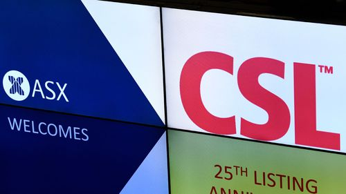 An ASX electronic billboard is visible during the commemorative event for the 25th anniversary of listing on the Australian Securities Exchange (ASX) in Sydney