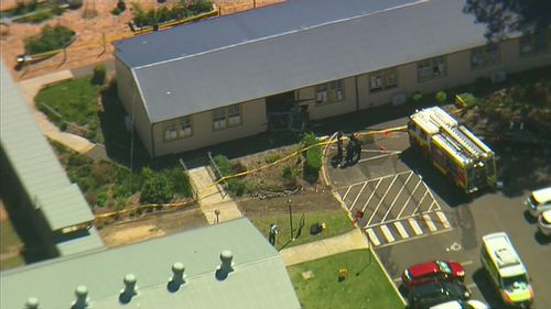 The female driver crashed into the classroom after she was distracted by something in her car, police said. (9NEWS)