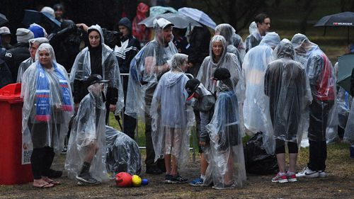 People are seen outside of Princes Park ahead of the AFLW grand final in Carlton North. (AAP)