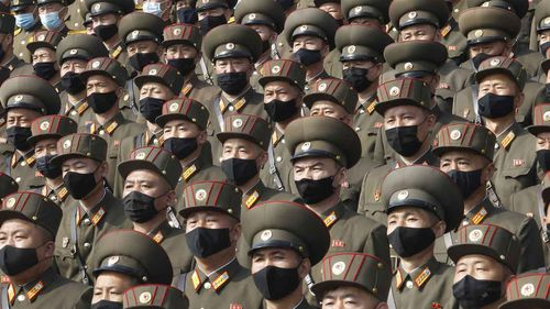Aoldiers wearing face masks to help curb the spread of the coronavirus rally to welcome the 8th Congress of the Workers' Party of Korea at Kim Il Sung Square in Pyongyang.