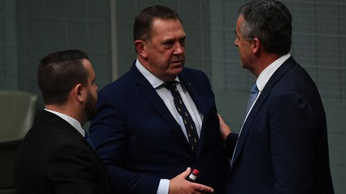 Member for Braddon Gavin Pearce (centre) and Minister for Veterans Affairs Darren Chester (right) following debate on a Royal Commission into Veteran Suicides in the House of Representatives.