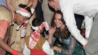 Kate speaks to a child who danced in the festival.