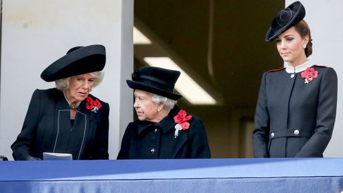 The Duchess of Cornwall, Queen Elizabeth II and the Duchess of Cambridge on a balcony during the remembrance service at the Cenotaph memorial in Whitehall, central London.