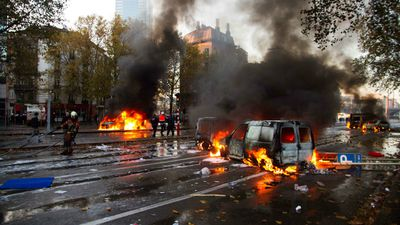 Belgian riot police have fired tear gas and water cannons during clashes with demonstrators as at least 100,000 people marched through Brussels in the first mass protests against the new government's austerity measures. (AAP)