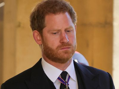 Prince Harry looks solemn at Prince Philip's funeral