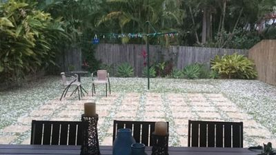 Hail blankets a Nudgee backyard. (Supplied)