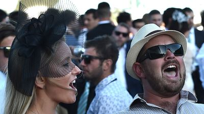 These racegoers belted out the national anthem. (AAP)