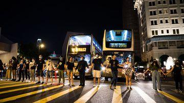 Hong Kong protesters join hands in 50-kilometre human chain