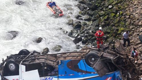 An injured man is transported across water to safety. Photo: AAP