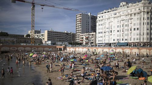 In this July 25, 2020, file photo, beachgoers enjoy the sun at the Plage des Catalans in Marseille, southern France.