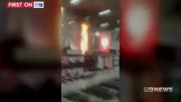 VIDEO: Queensland suburban department store goes up in flames