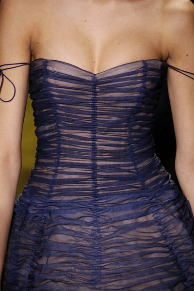 <p>Christian Dior Haute Couture Spring 2017.</p> <p>Ruched, fitted bodices with a hint of cleavage.</p>