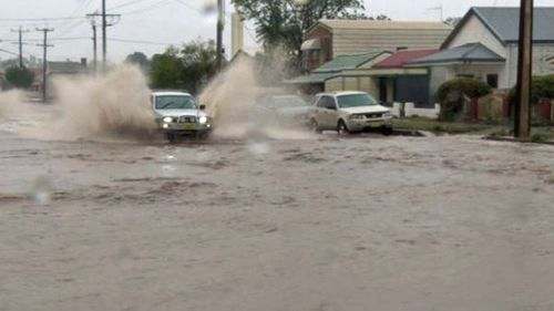 Broken Hill inundated with month's worth of rain in 15 minutes.