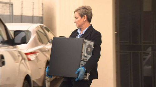 Police seizing hardware from Integrity Care in Adelaide.