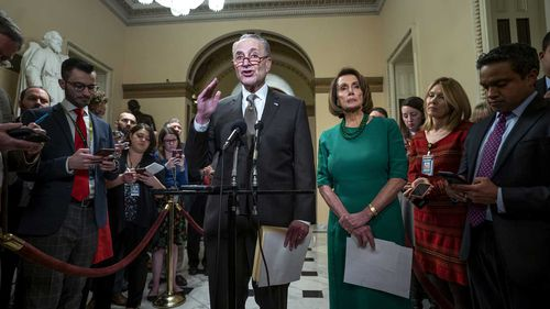 Democratic leaders Chuck Schumer and Nancy Pelosi speak to the press.