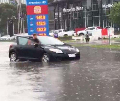 On the Kingsway, motorists were left pushing their vehicles through floodwaters.