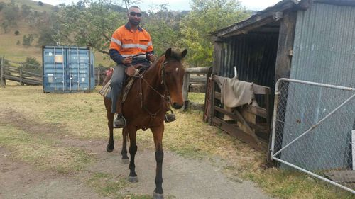Mark Basa on prison work assignment working with therapy horses. (Supplied)