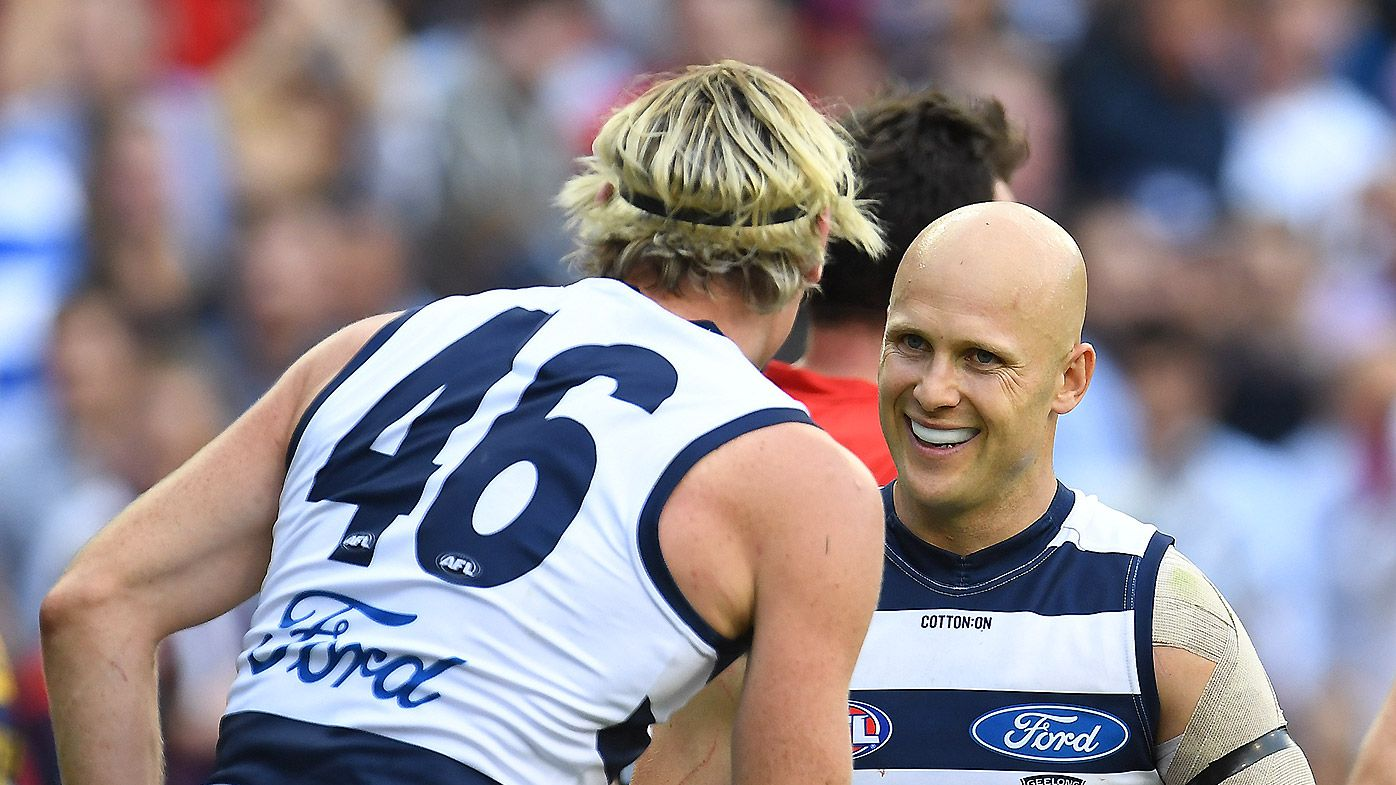 Mark Blicavs (left) and Gary Ablett of the Cats