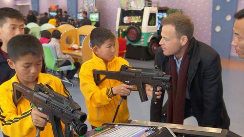 Children at a North Korean school tote guns. (60 Minutes)