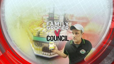 Family grocer vs council