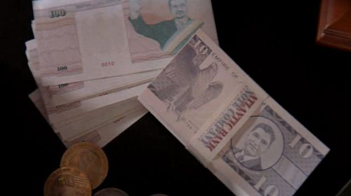 Atlantium has its own postal stamps and currency. (Craig Rasmus)