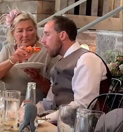 Drunk groom is hand-fed by mother-in-law at wedding