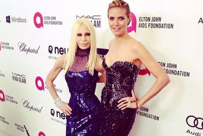 Strike a pose! Donatella Versace and Heidi Klum happily share the limelight on Elton John's post-Oscars red carpet.