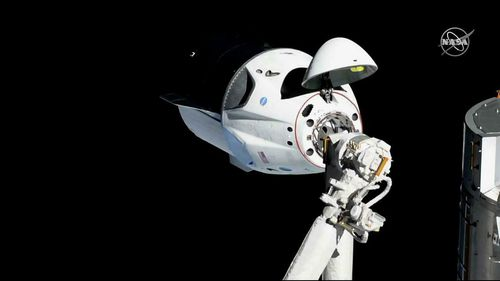 The SpaceX Crew Dragon is pictured about 20 meters away from the International Space Station's Harmony module