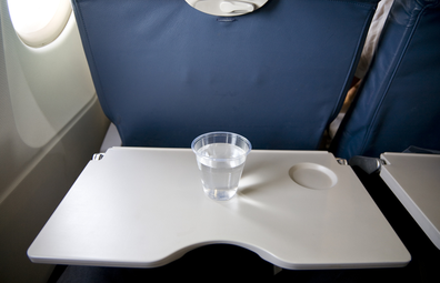 Cup of water on a plane