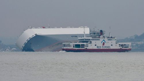 The Hoegh Osaka, a car carrier, has become stranded on Bramble Bank, in the Solent between Southampton and the Isle of Wight. (AAP)