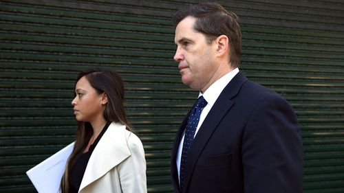 Ryan Phelan and lawyer Claudette Chua (Joel Carrett).