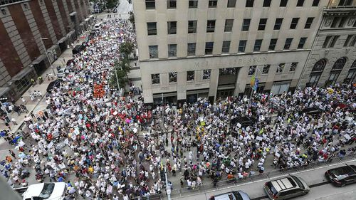 Protesters march through the streets of Houston, Texas, on the way to Senator Ted Cruz's office. (AAP)
