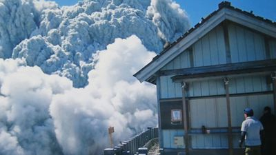 Before he died, hiker Izumi Noguchi took this photo showing gas and ash gushing from the summit crater at Mount Ontake.