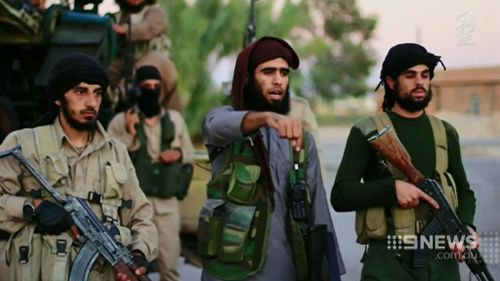 One militant speaks in the video. (9NEWS)